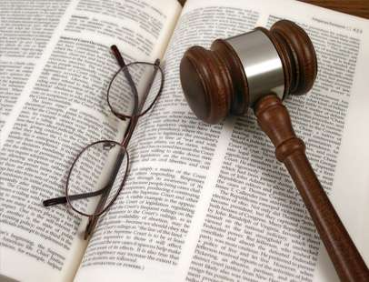 Gavel and glasses laying on a book